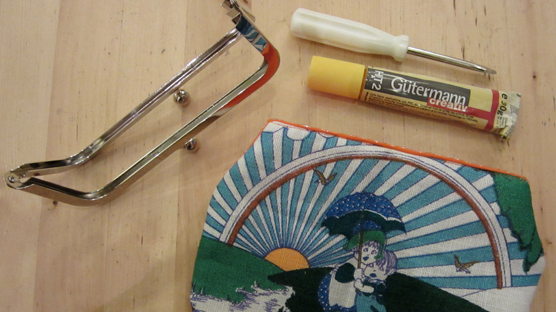 Glue + screw driver = final stage to making your very own snap frame purse