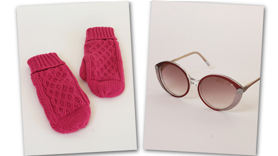 Hot pink cable knit mittens and sunglasses with a swooping bird like motif.