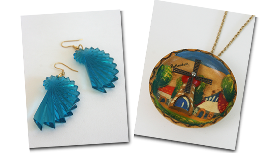 A pair of turquoise fan earrings and a wooden windmill giant pendant.