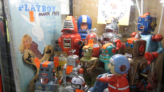A whole cabinet dedicated to vintage Playboys and robots in Snooper's Paradise.