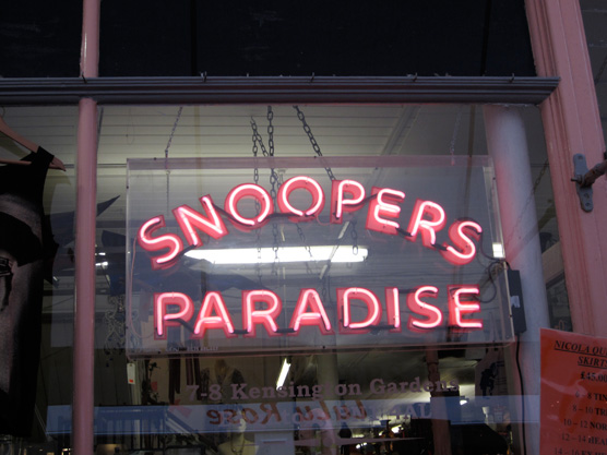 The Snoopers Paradise neon pink sign.