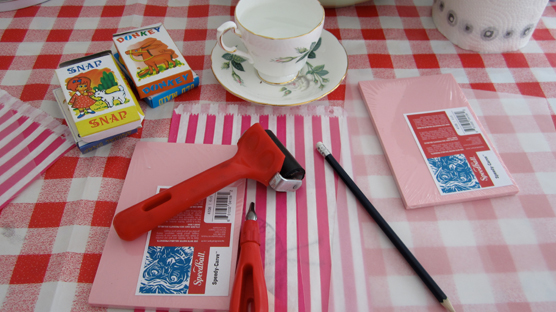 The tools of the printmaking trade along with vintage playing cards & tea cups of lemonade.