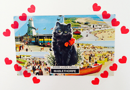 A kitsch black cat postcard to bring you luck from Mablethorpe.