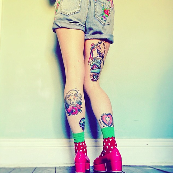 Cute 'n creepy tatts to die for.